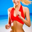 Young attractive happy smiling blond woman in sport wear running — Stock fotografie