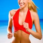 joven atractiva mujer rubia sonriente feliz en desgaste del deporte corriendo — Foto de Stock
