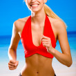 Stock Photo: Young attractive happy smiling blond woman in sport wear running