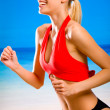 Young attractive happy smiling blond woman in sportswear running — Stock fotografie