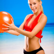 Young beautiful happy smiling blond woman in sportswear playing — Stock Photo