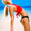 Young sexy smiling happy blond woman in sportswear doing fitness — Stock Photo