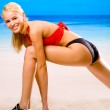 Young sexy smiling happy blond woman in sportswear doing fitness — Stock Photo #6306792