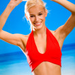 Young happy smiling beautiful blond woman playing with flying di — Stock Photo #6306818