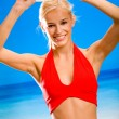 Young happy smiling beautiful blond woman playing with flying di - Stock Photo