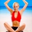 Young attractive happy smiling blond woman in sportswear doing y — Stock Photo