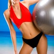 Young attractive happy smiling sexual woman in sportwear with pi — Stock Photo