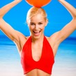Royalty-Free Stock Photo: Young beautiful happy smiling blond woman in sportswear playing