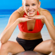 Young woman doing fitness exercises with pilates gym ball - Stock Photo