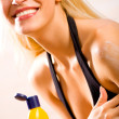 Young beautiful sexy blond tanned smiling woman with sun-protect - Foto de Stock