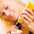 Young beautiful smiling woman with sun-protection cream on the b — Stock Photo