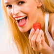 Young beautiful tanned happy sexy smiling blond woman with straw - Stock Photo