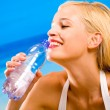Young beautiful sexy tanned happy smiling blond woman with bottl — Stock Photo #6307185
