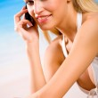 Young woman with cellphone in bikini on the beach — Stock Photo #6307249