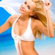 Stock Photo: Young beautiful tanned happy smiling blond woman in bikini on se