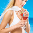 Young beautiful woman in bikini with cocktail on beach — Stock Photo