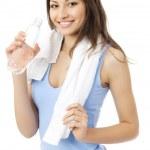 Frau im Sportswear-Trinkwasser, isoliert auf weiss — Stockfoto