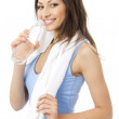 Woman in sportswear drinking water, isolated on white — Stock Photo