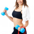 Portrait of young happy smiling woman in sportswear with dumbbel — Stock Photo #6308738