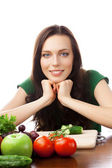 Portrait of happy smiling woman with vegetarian food, isolated o — Stock Photo
