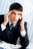 Thinking, tired or ill with headache businessman at office — Stock Photo