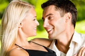 Portrait of young happy attractive couple together, outdoors — Stock Photo