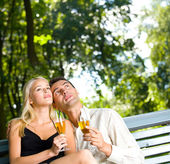 Young couple celebrating with champagne outdoors. To provide max — Stock Photo