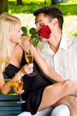 Funny scene of couple celebrating with champagne and rosa, outdo — Stock Photo