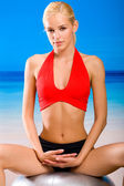Young woman in sportswear with pilates gym ball — Stock Photo