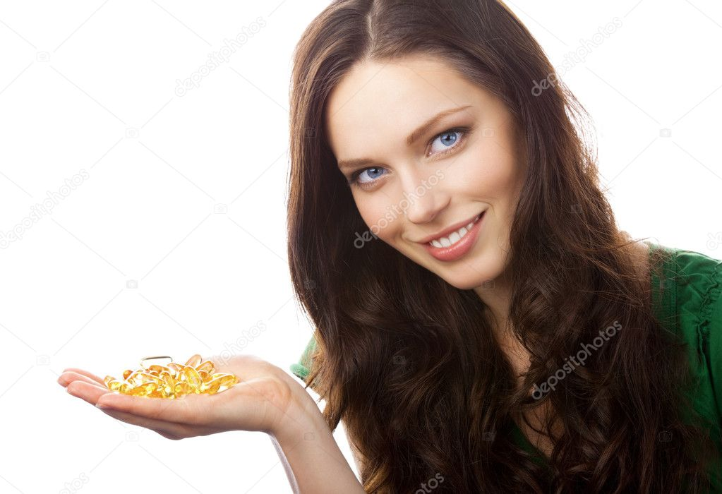 Portrait of woman showing Omega 3 fish oil capsules, isolated on white background — Stock Photo #6303322