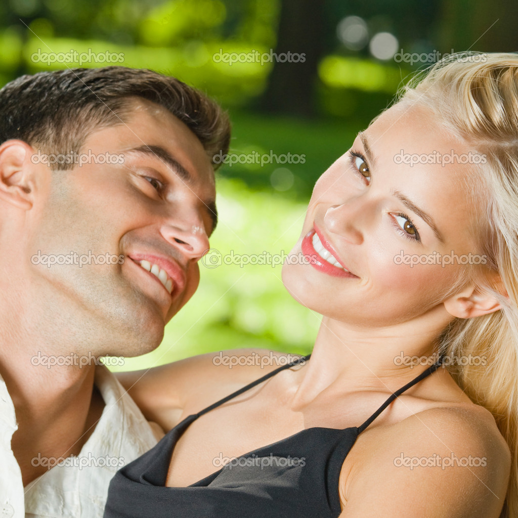Young happy amorous embracing couple, outdoors  Stock Photo #6304842