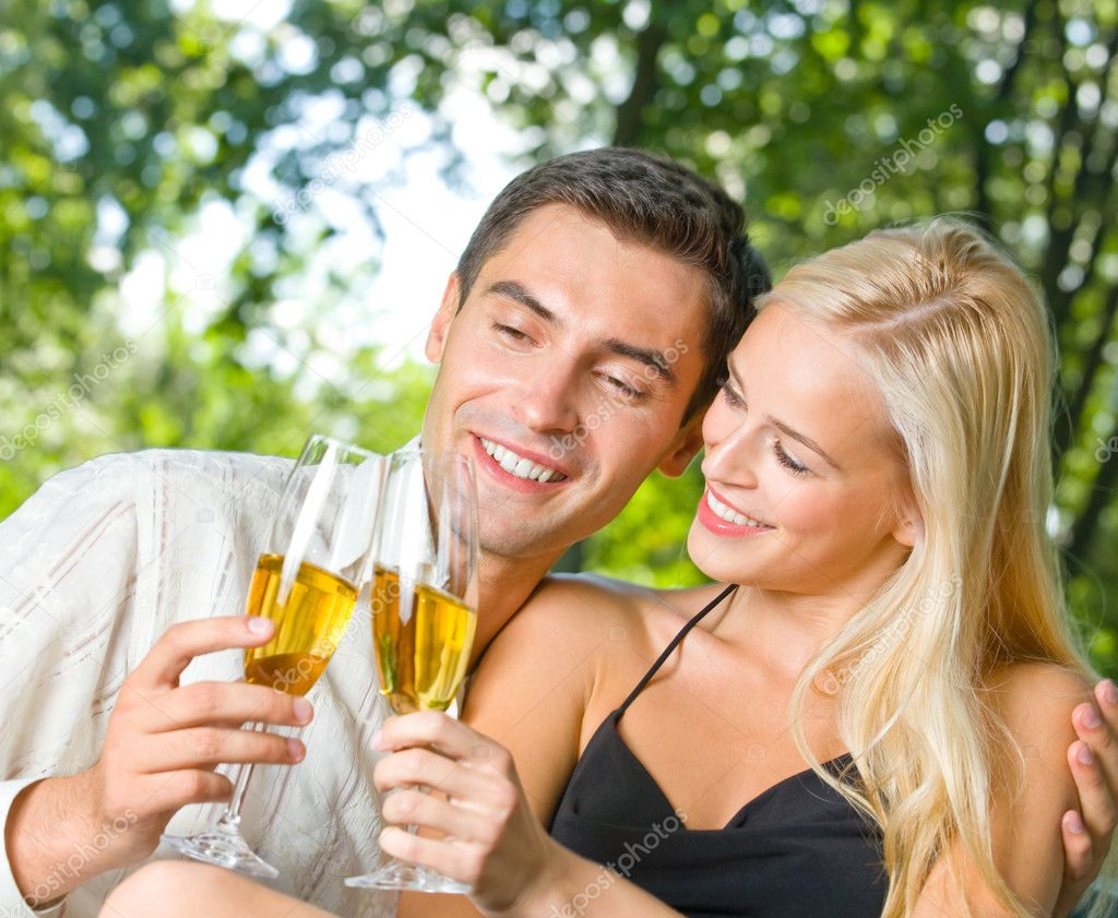 Young happy couple celebrating with champagne, outdoors — Stock Photo #6304852