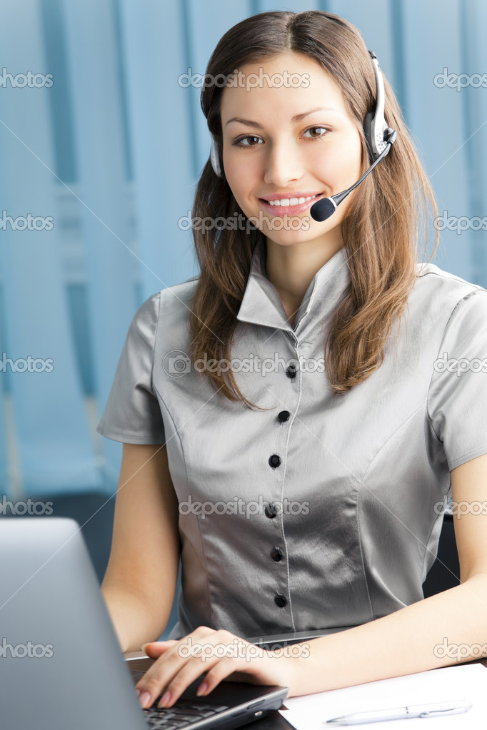Support phone operator in headset at workplace  Stock Photo #6307891