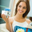 Young happy smiling woman with gift boxes at home — Stock Photo