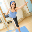 Young happy woman exercising at home — Stock Photo