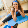 Young happy woman doing fitness exercises at home — Stock Photo