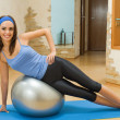 Young happy woman doing fitness exercises at home — Stok fotoğraf