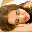 Young attractive woman sleeping at home — Stock Photo