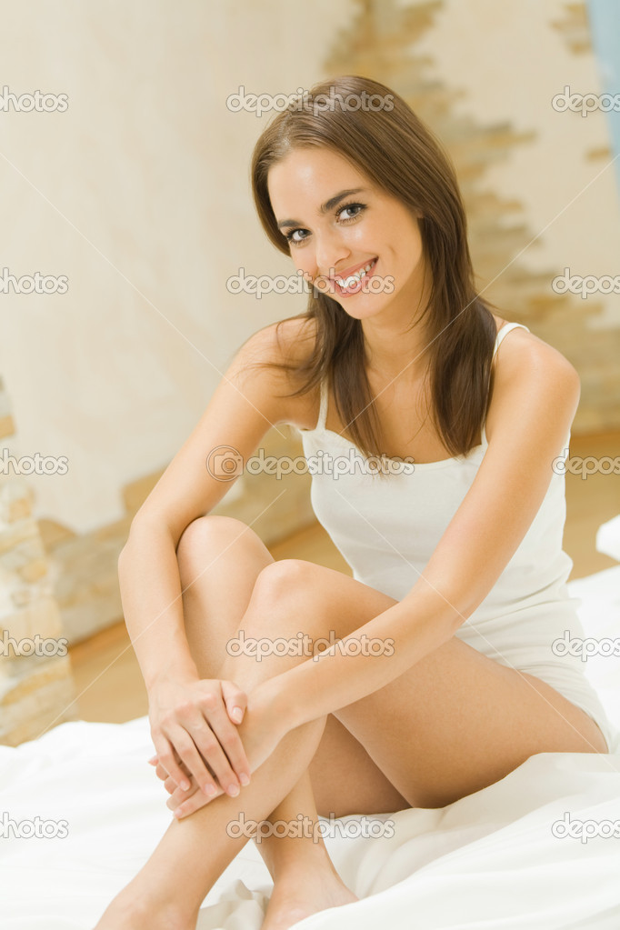 Young happy smiling attractive woman in lingeria at bedroom  Stock Photo #6312589
