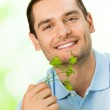 Young attractive happy smiling man with potherbs — Stock Photo #6325058