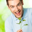 Young happy smiling man with potherbs, outdoors — Stock Photo #6325073