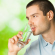 Young man drinking water, outdoors — Stock Photo #6325136