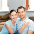 Portrait of young happy smiling couple - Stock Photo