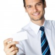 Businessman with business card, on white — Stock Photo