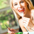 Young happy smiling woman eating vegetarian salad — Stock Photo #6395915