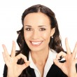 Business woman with okay gesture, on white - Stock Photo