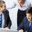 Three businesspeople working at office — Stock Photo