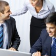 Three businesspeople working at office — Stockfoto