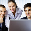 Three businesspeople working with laptop at office — Stockfoto #6429163