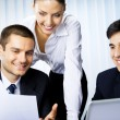 Стоковое фото: Three businesspeople working with document at office